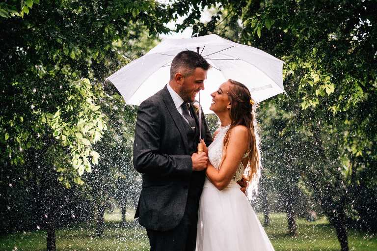 Rainy wedding at The Gardens in Yalding
