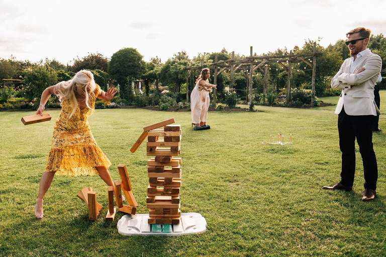 Playing Jenga at a wedding at The Gardens in Yalding