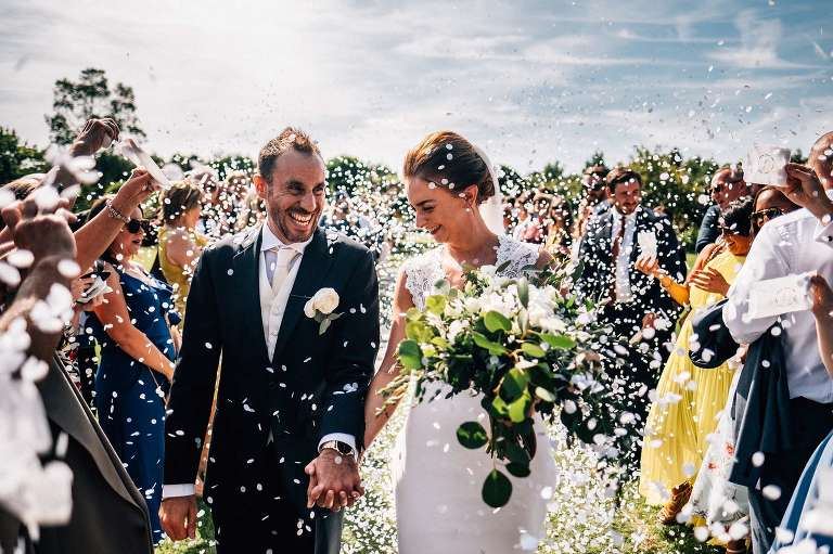 Confetti with the bride and groom at their August wedding at The Gardens in Yalding